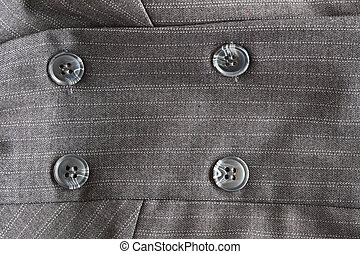 Button on a gray suit