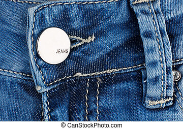 Button on blue jeans.