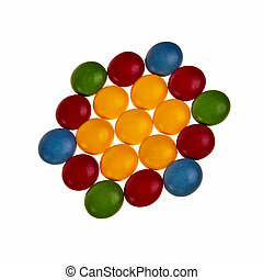 Button shaped colorful candies over white background in hexagon pattern.