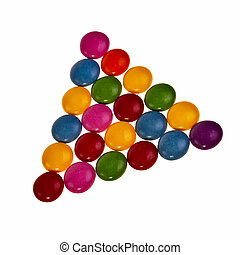 Button shaped colorful candies over white background in triangle pattern.