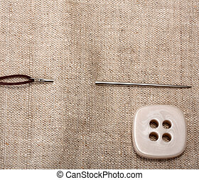 button, thread with a needle