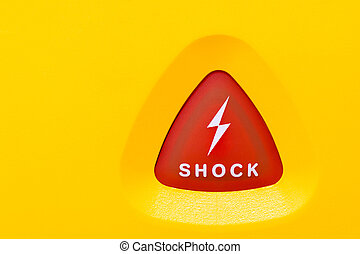 button to apply an AED shock - Button on an AED to apply an...
