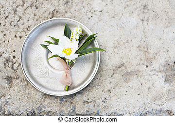 Buttonhole for groom on the gray concrete background