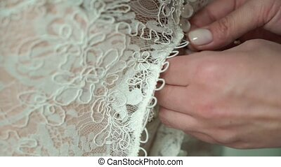 Buttoning wedding dress, put on bridal gown