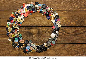 Buttons on a wooden board