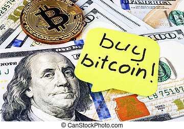 Buy Bitcoin written on a memo stick. Cryptocurrency trading.
