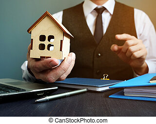 Buy home or get mortgage. Realtor proposes model of house.