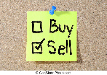 Buy or sell check boxes written on a board