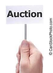 auction - buy or sell on auction concept with hand holding ...