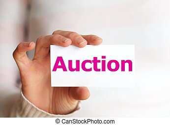 auction - buy or sell on auction concept with hand holding...