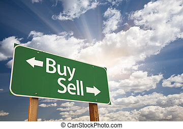 Buy, Sell Green Road Sign Against Clouds