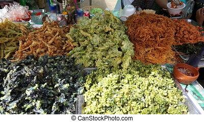 Buy spicy thai appetizer at market, Thailand (Panning shot)