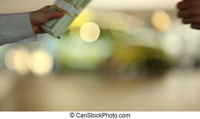 Buy - Human hand giving dollar bill to business partner