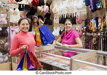Buyer  and salesman  at  counter in underwear shop