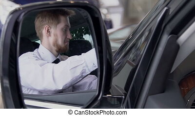 Buyer is pretty inspecting auto interior and is reflected in...