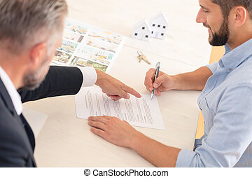 Buyer signing contract with developer
