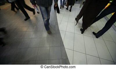 buyers going in mall, view on floor, wide angle