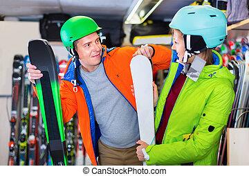 Buyers in equipment are choosing ski in store.