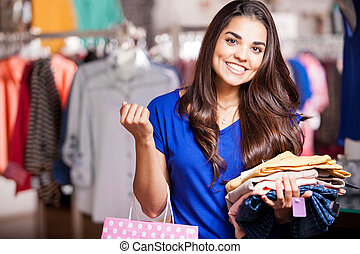 Buying a new outfit for tonight - Pretty girl holding a...