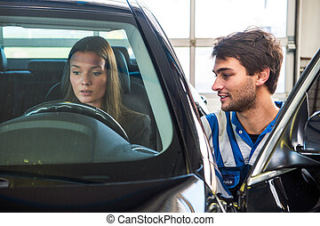 Buying a used car - Young woman, behind the wheel of a...