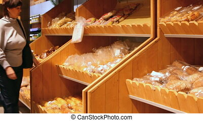 Buying bakery products - Husband and wife buying bakery...