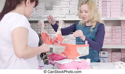 Buying clothes for pregnant and nursing mothers in baby and maternity shop