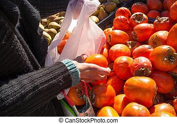 Buying fruit at a market stall