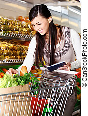 Buying goods in supermarket - Image of pretty woman choosing...