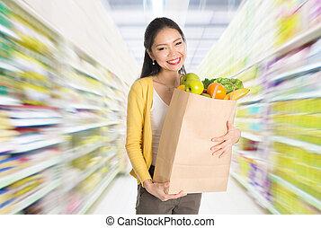 Buying groceries in market