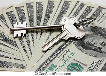keys on stack of hundred-dollar bills
