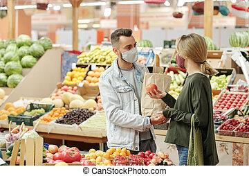 Buying organic food at market