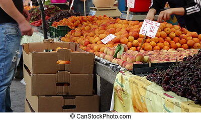 Buying Peaches - Man is buying fresh organic peaches form a...