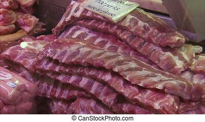 Buying pork's rib at the supermarket - A medium shot of...