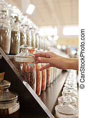 Buying savory spices - Close-up of unrecognizable customer ...