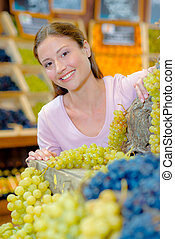Buying some grapes