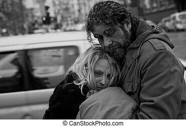 b/w homeless couple embracing