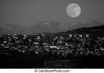 bw moon over the small village