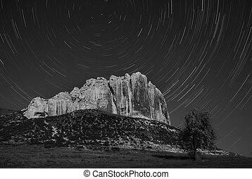 BW mountaine and startrails in sky