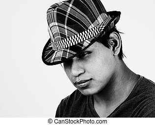 B&W portrait of young latino man with hat