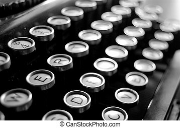 the close up view of old fashioned typewriter keys set in black and white
