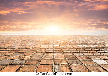 By bricks tiles in sunset