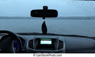 By car in the lake