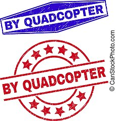 BY QUADCOPTER badges. Red rounded and blue flatten hexagonal BY QUADCOPTER rubber imprints. Flat vector scratched watermarks with BY QUADCOPTER caption inside rounded and expanded hexagonal shapes.