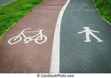 Bycicle and pedestrian sign painted on the road asphalt