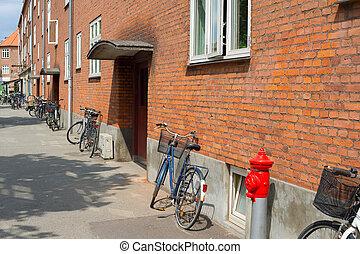 Bycicles old building apartment. Copenhagen
