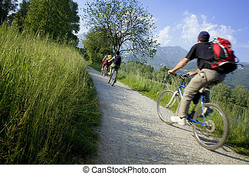 bycicles02 - couple biking in the country