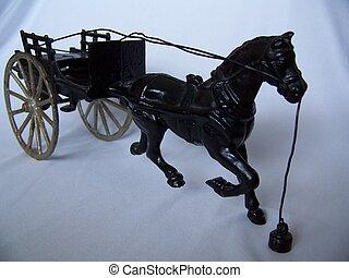 bygelhäst och barnvagn