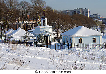 """BYKOVO, MOSCOW REGION, RUSSIA - November, 2014: Winter day in the Russian village. The church-chapel of the Mother of God """"Life-Giving Spring"""" on the river Bykovka"""