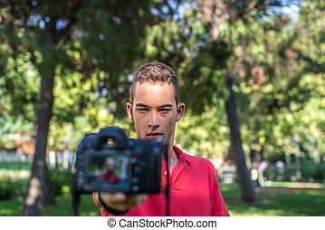cámara fotográfica de la foto, joven
