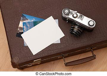 cámara, maleta